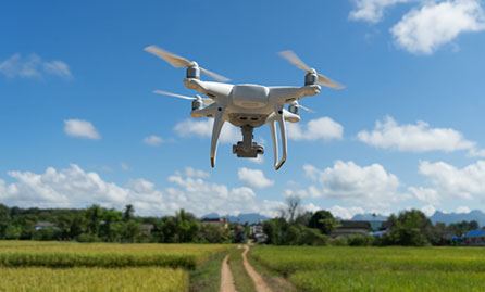 Drone flying over field