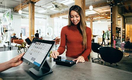 Female swiping credit card at POS
