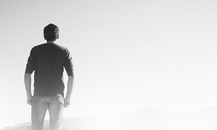 Man looking into a distant landscape